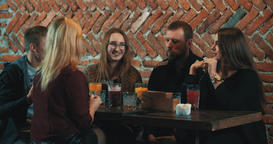 Friends sitting talking at bar 4k video. Women man cafe Footage