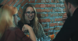 Friends talking at bar 4k video. Young women man at cafe table Footage