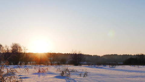 Snowy field. Sunset. Russia Footage
