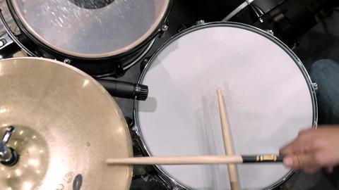Drummer using drumsticks Live Action