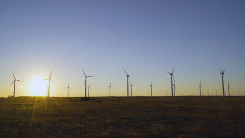 Rotating Wind turbine blades at wind farm in Bulgaria at sunset Live Action
