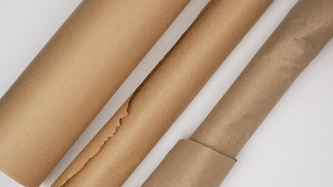 twisted roll of brown parchment paper on a white background, wax baking paper Live Action