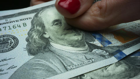 Woman counting enjoying dollar banknotes in hands. Lady receiving salary Live Action