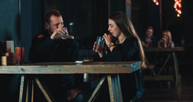 Couple date toast cheers drink cocktails at bar 4k video Footage