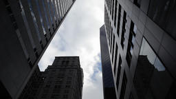 Clouds seen thru skyscrapers in NYC New York City Manhattan Footage