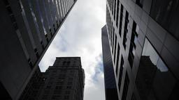Clouds seen thru skyscrapers in NYC New York City Manhattan Footage