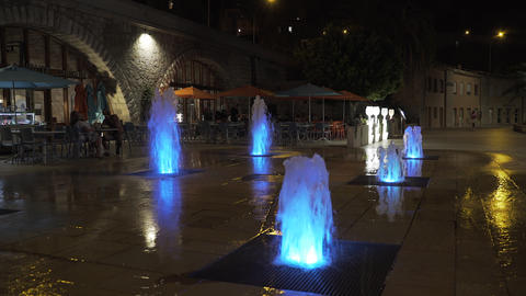 Illuminated water jets at night Live Action