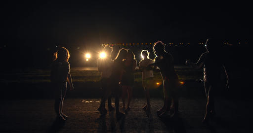 Young people are drinking at the party at night, having fun, lifestyle, 4k Live Action