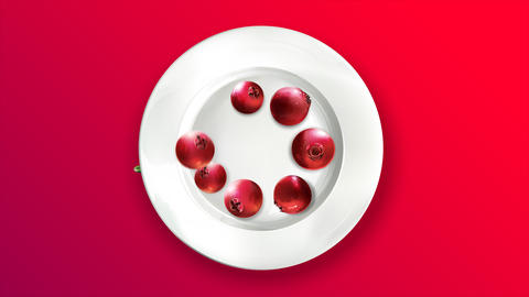 Several fresh lingonberries on a white plate Animation