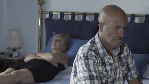 couple crisis: partners stay silently on the bed with serious problems Footage