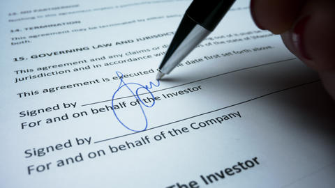 Business woman hand signing document with pen. Female signing business contract Live Action