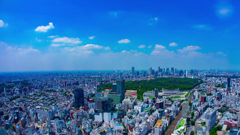 A timelapse of panoramic cityscape at the urban city in Tokyo high angle panning Live Action