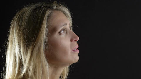 closeup portrait on beautiful eyes ready to cry: sad woman Footage