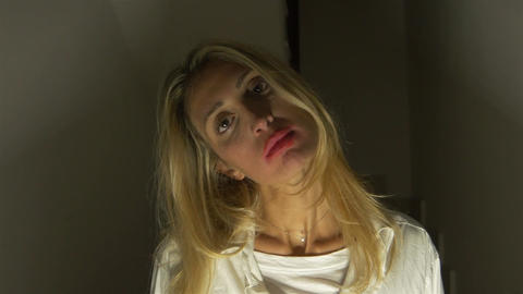 devilish blonde woman looks at the camera ビデオ