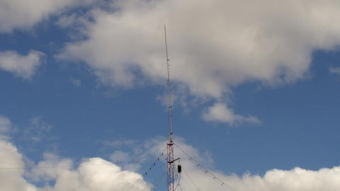 Home based single spike Telecommunications antenna tower heavy clouds day time l Footage