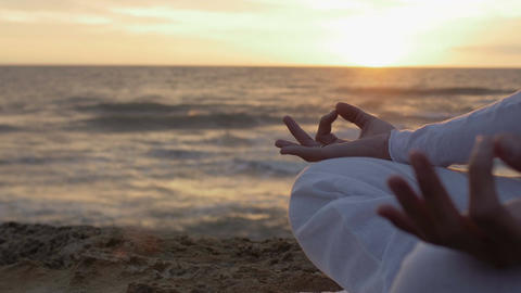 woman having meditation at the sunset: practicing yoga near the sea Footage