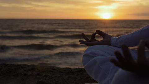 making yoga position at the sunset on the beach: sea, woman, lonely, meditation Footage