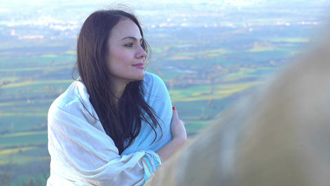 beautiful woman smiles with wonderful clouds in... Stock Video Footage