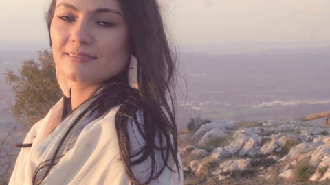 relaxing young woman on the top of a mountain: relaxed,... Stock Video Footage