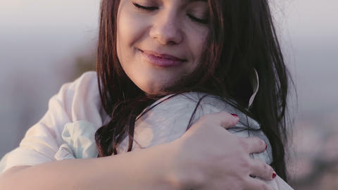 beautiful woman feeling cold: peaceful and relaxed woman…, Live Action