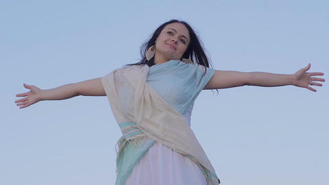 dreaming young woman opens her arms to the sky: fly into the wide Footage