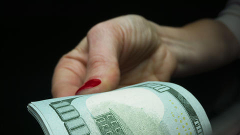 Woman counting cash money on black background. Finance and cash concept Live Action