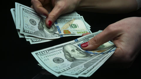 Female hands holding cash money. Businesswoman counting money Live Action