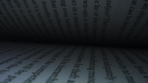 Open book with white pages. Camera moving between book pages of open book Live Action
