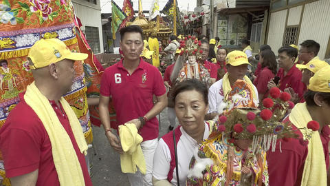 The staff carry statue deity for the procession Live Action