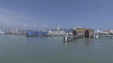 Blue Ferry parking at the Penang Port under blue sky Live Action