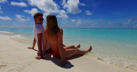 Man and lady tanning on tropical island beach adventure by turquoise sea and clean sandy background Live Action