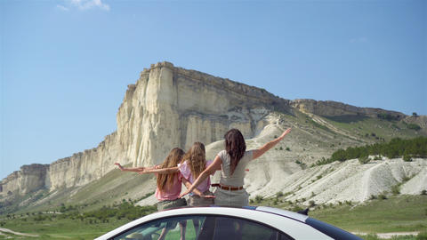 Mother and little daughters on summer car vacation Live Action