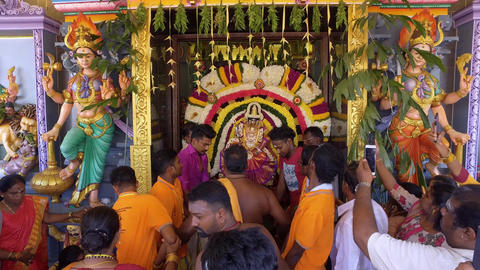 Man carry god on the altar to out the temple for procession during Live Action