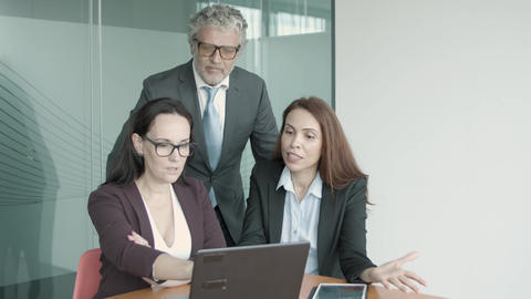 Caucasian female managers showing project on laptop to CEO Live Action