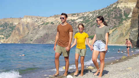 Young family on white beach during summer vacation Live Action