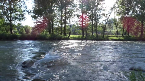 Rocks causing breaks in the river flow Live Action
