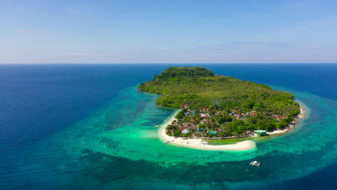 Turquoise water and coral reefs around the island. Summer holiday vacation Live Action