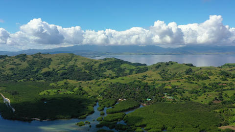 Tropical landscape, view from above. Large tropical island with green hills Live Action