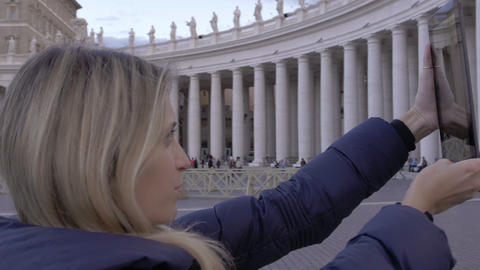 young woman is making photos to St. Peter church with tablet pc: tourism in Rome Footage