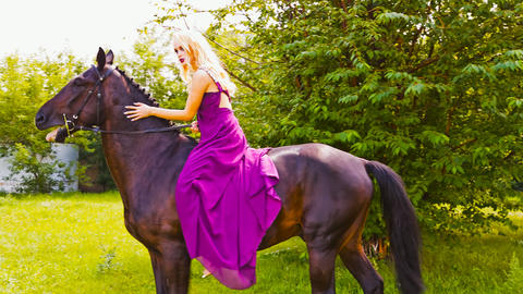 Beautiful girl in the park with a horse Image