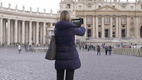 cute woman using tablet computer to make photos to St. Peter Cathedral in Rome Footage