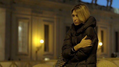 young sad and lonely woman feels cold in Rome: st. Peter square in the night Footage