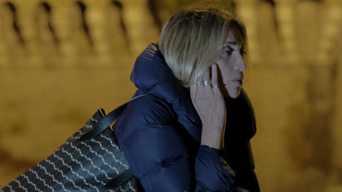 sad and depressed young woman in the street of Rome during winter nights Footage