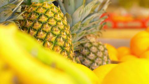 fresh fruits on the market stand: ananas, grapefruit, banana, yellow Footage