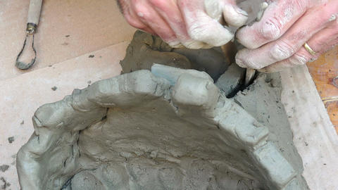 artisan is making a clay sculpture in Italy Live Action