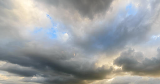 Clouds in the light of the setting sun. Time Lapse. Natural HDR Footage