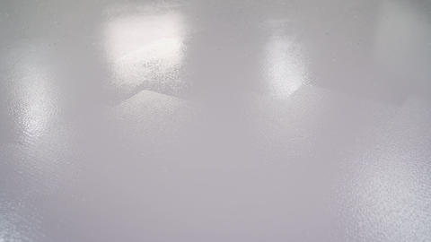 The floor is painted with white paint. Dry white paint on the concrete floor Live Action