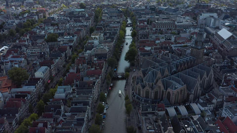 Amsterdam Canal and Old Cathedral from Drone Perspective, Crane Live Action