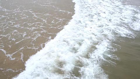 Waves kissing the sea shoreline Live Action