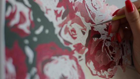 Artist paints picture close-up. Girl paints a picture with acrylic paints Live Action